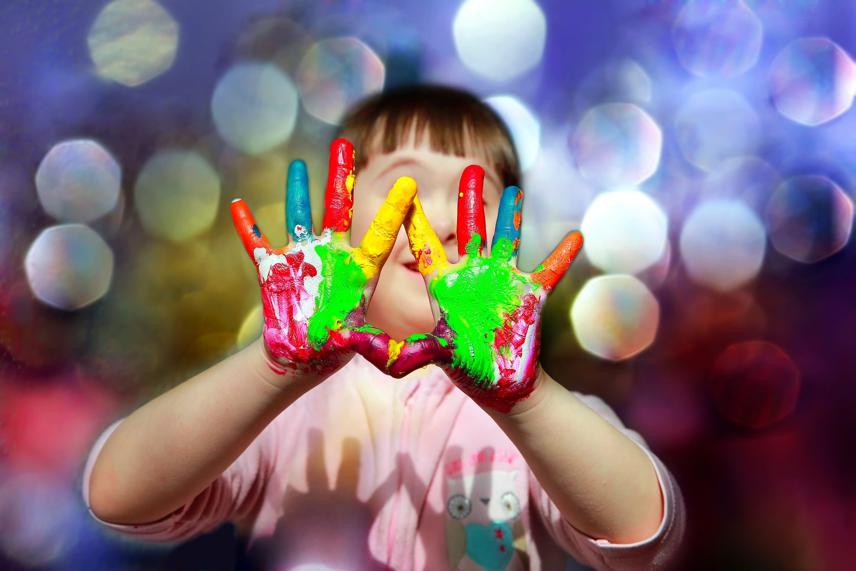 Cute little kid with painted hands.